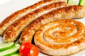 grilled meat sausages on a white background
