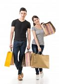 Asian couple shopping, full length portrait isolated on white background.