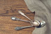 vintage tea spoons on wooden background