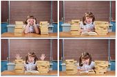 Cute Schoolgirl At A Desk With Books