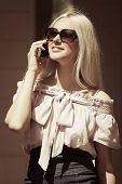 Blond fashion woman calling on the cell phone