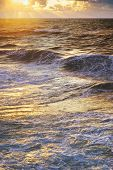 Sea waves on sunset. Nature composition.
