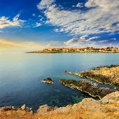 Ancient City On A Rocky Shore Near Sea At Sunrise
