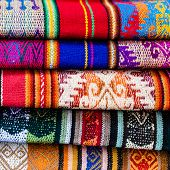 Colorful stack of blankets