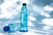 Bottles of water on blue background