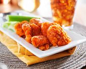 plate of boneless buffalo flavored chicken wings