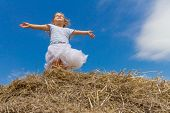 outdoor portrait of young cute child girl on sky background