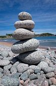 stock photo of gneiss  - Gneiss stones piled high on a rocky beach in Cape Breton National Park - JPG