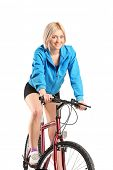 Beautiful woman riding a bicycle isolated on white background