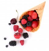 Different ripe berries in sugar cone, isolated on white