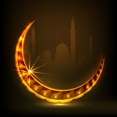 Golden stars decorated crescent moon on mosque silhouetted brown background for Muslim community fes