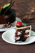 festive beautiful chocolate cake with icing and cherry