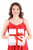 Beautiful young girl in red dress with gift isolated on white