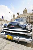 HAVANA, CUBA - JANUARY 28, 2012: Old classic car parked in front of the Revolution museum, formerly