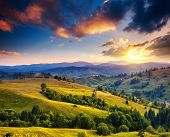 Beautiful green hills at dusk. Dramatic overcast sky. Carpathian, Ukraine, Europe. Beauty world.