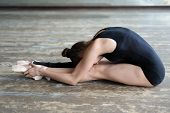 Ballet dancer stretching out sitting on the floor
