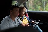 Two boys in the car with tablet PC