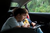 Boys in the car using a touchpad
