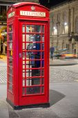 Classic red British telephone box, night scene