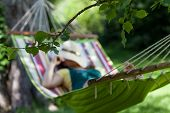 Woman Sleeping On A Hammock