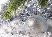Silvery New Year's ball. Christmas still life
