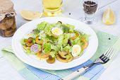 Fresh salad with mushrooms squid and quail eggs