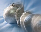 Beautiful silvery New Year's ball and elegant tinsel