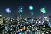 Fireworks Celebrating Over Tokyo Cityscape At Night