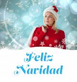 happy festive blonde with shopping bags against feliz navidad