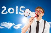 Geeky businessman shouting through megaphone against cloudy sky with sunshine