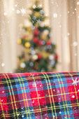foto of blanket snow  - Warm blanket on the couch at christmas against snow falling - JPG