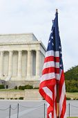 United States flag with Lincoln Memorial background - Washington DC, USA