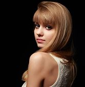 Pretty Woman With Blond Bob Hair Style Posing On Black