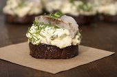 Herring Fillet On Toasted Rye Bread And Salad With Eggs, Green Onions, Dill And Mayonnaise.