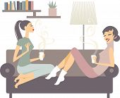 Female Friends With Coffee Cups Talking At Home