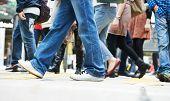 Pedestrians crossing a street. Urban rush hour