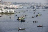Residents of Dhaka cross Buriganga river by boats in Dhaka, Bangladesh.