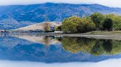 A mirror-like lake framed by clouds in New Zealand