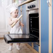 baby chef cooks in the oven food