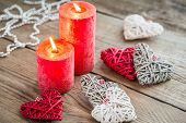 Hearts With Burning Candles On The Wooden Background