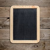 Small Blackboard On Old Wood Background