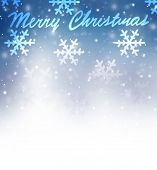 Merry Christmas greeting card, beautiful abstract wintertime border, many snowflake falling on blue background with white copy space, happy winter holidays