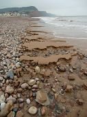 Beach Stones And Sand Erosion Seascape