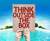 Think Outside the Box card with a beach on background