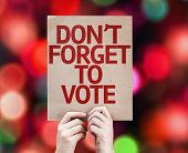 Don't Forget to Vote card with colorful background with defocused lights