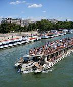 Tourists On A Seine River Boat Tour Of Paris, France.