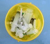 Medical Syringes In The Trash Bin