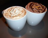 pic of whipping  - Latte coffee with whipped cream and gingerbread next to a hot chocolate with whipped cream,caramel syrup and chocolate syrup.  Picture taken on November 7, 2014. - JPG