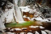 waterfall in the woods in winter, Casoca, Romania