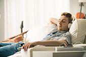 Guy With Headphones On Sofa